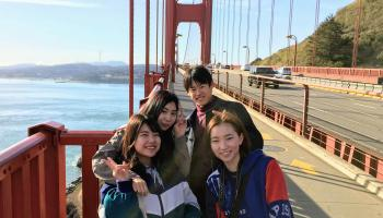 A group of people touring the Golden Gate Bridge.